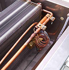 Available top-mounted evaporator coil